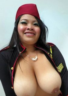 Hot Thai girl with enormous tits poses for camera before her first babreback video.
