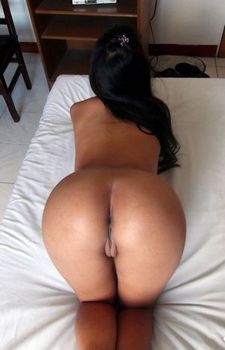 Nakedly smooth ass and pussy spread and on display.