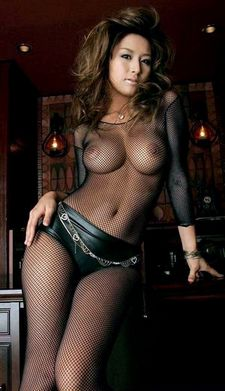 Fishnet bodysuit and leather hotpants.